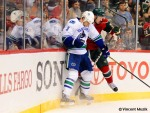 Vancouver Canucks' Kevin Bieksa and the  Minnesota Wild's Cal Clutterbuck